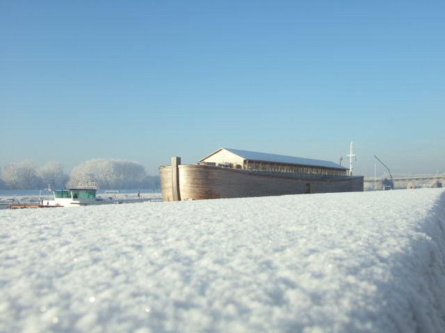 The Ark floating through a Dutch winter landscape for transport to it's next berth.