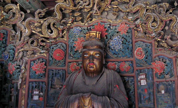 The Buddha statue inside the sanctuary of The Hanging Temple.