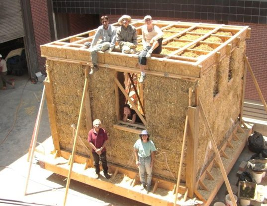 A look into the inner construction of a straw made house.